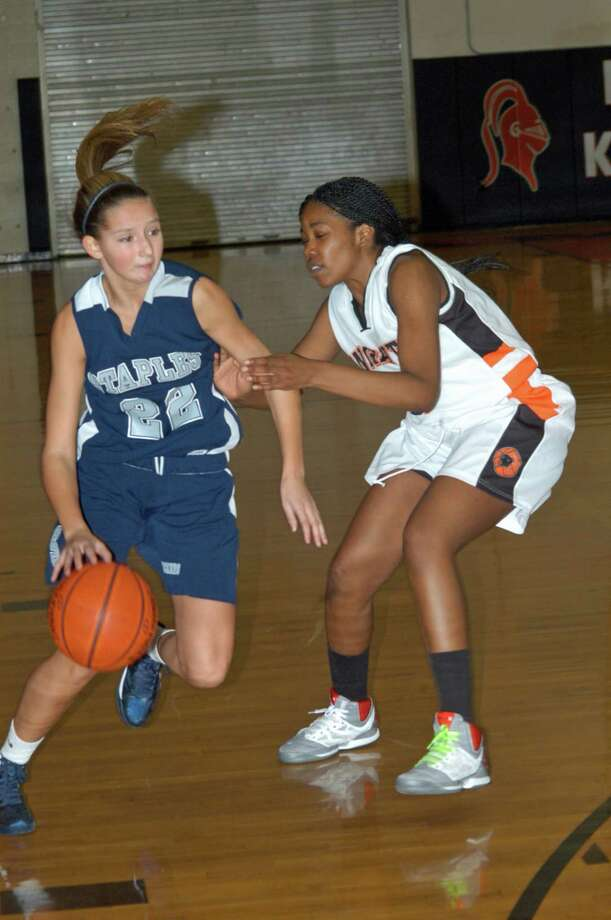 Staples High senior guard Nicole Bukovsky tries to drive around a defender in the Wreckers' 56-32 loss to Stamford on Friday evening. Photo: Contributed Photo