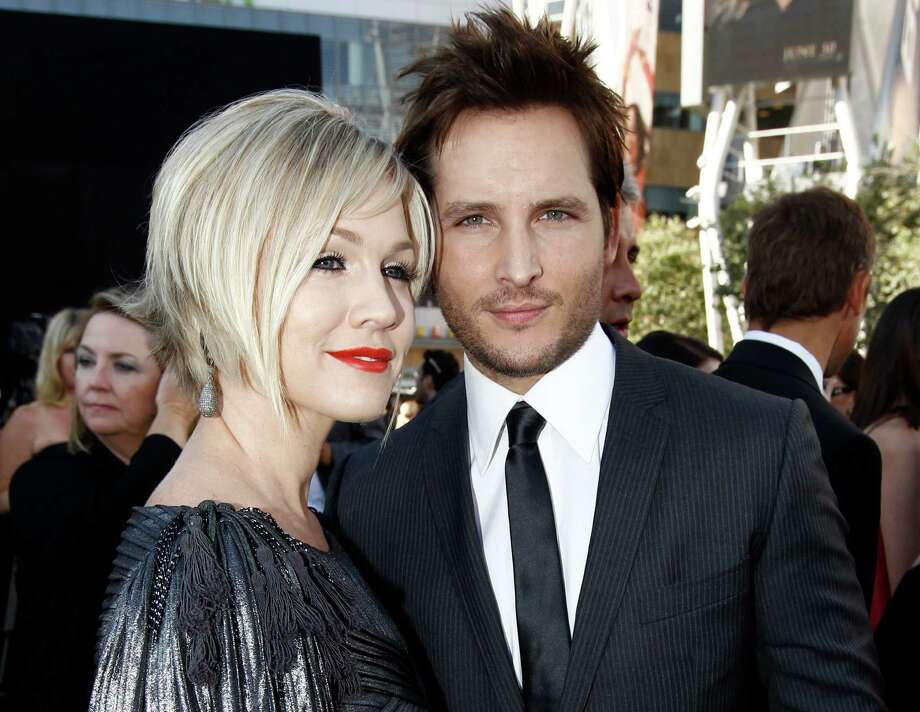 "Divorced: Jennie Garth and her husband, Peter Fancinelli of the ""Twilight"" franchise, filed for divorce in Los Angeles on Wednesday, March 28 citing irreconcilable differences for their breakup after nearly 11 years of marriage. They have three children together.  Photo: Matt Sayles, Associated Press / AP2010"