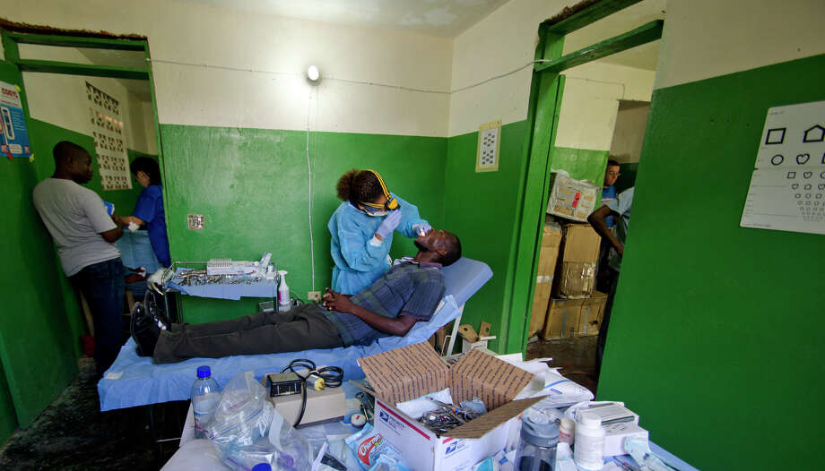 Dr. Chedly Schatzie Vincent, owner of the Aspen Dental practices in Fairfield and Norwalk, provides free dental care to Haitians in the town of Jacmel, a town devastated by the 2010 earthquake, during a recent humanitarian trip. Photo: Contributed Photo / Norwalk Citizen