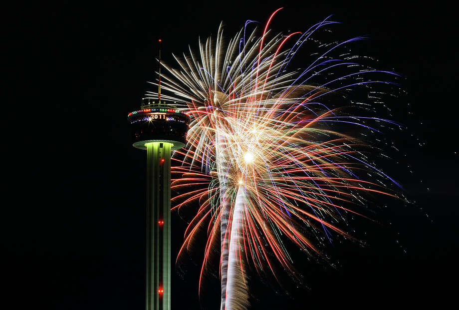 Fireworks explode around the Tower of the Americas during a past Celebrate San Antonio event. Photo: Express-News File Photo / eaornelas@express-news.net