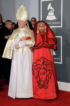 God bless Nicki Minaj and her blasphemous sense of style. With our eyes radar-ready for the worst in fashion, this was a no-brainer. After all, red-carpet-bagging is our fave sport, so when Minaj arrived at the Grammys in a ruby-red Atelier Versace nun's habit, we fell to our knees and thanked the heavens for this fabulous fiasco. Photo: Jason Merritt, Staff / 2012 Getty Images