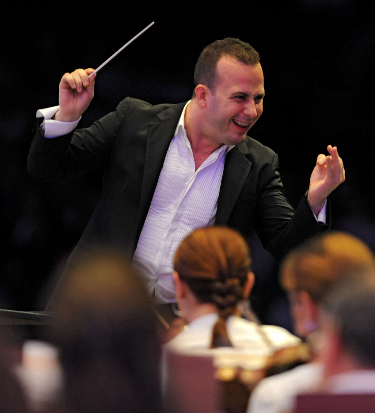 Music director Yannick Nezet-Seguin conducts the Philadelphia Orchestra at Saratoga Performing Arts Center Wednesday, Aug. 8, 2012 in Saratoga Springs, N.Y. This is Yannick Nezet-Seguin's first performance at SPAC. (Lori Van Buren / Times Union)