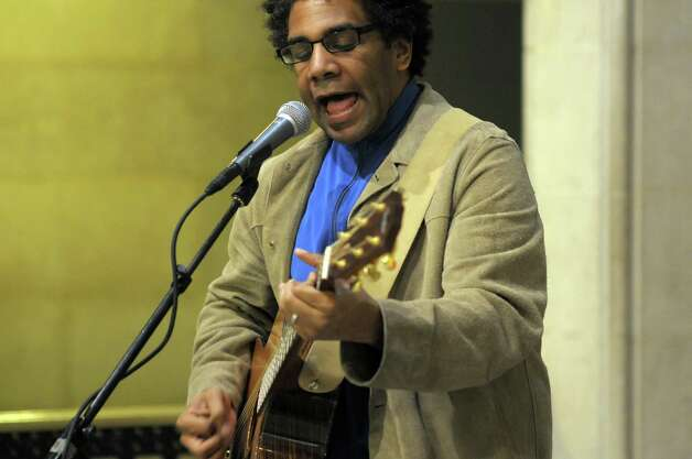 Musician Bryan Thomas from Delmar performs  during a press conference on Tuesday morning, April 12, 2011 at city hall in Albany to announce the musical acts and other events that will take place at this years Tulip Festival.  The festival will take place May 7 and 8.  Thomas will perform at 1:00 pm at the Tulip Festival Amp Stage on Sunday, May 8.  (Paul Buckowski / Times Union) Photo: Paul Buckowski / 00012726A
