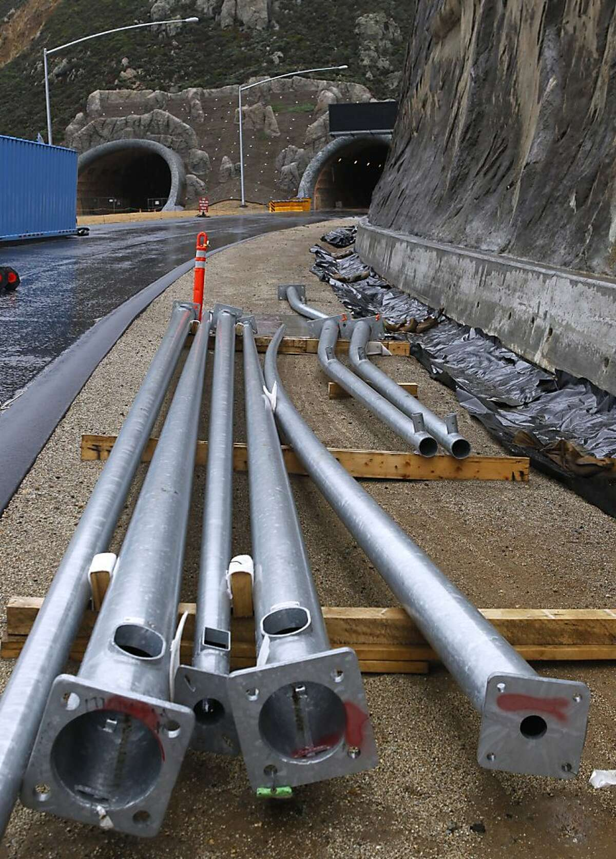 Utility poles wait to be installed on the south end of the Devil's Slide Tunnel project in Pacifica, Calif. on Friday, Dec. 21, 2012. Caltrans plans to open the twin bores early next year.