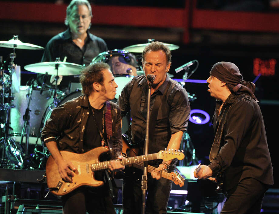 Bruce Springsteen performs to a sold out crowd at the Times Union Center on April 16, 2012 in Albany, N.Y. His original E-Street Band members Nils Lofgren, left, Steve Van Zandt, right, and Max Weinberg on drums back him up well. (Lori Van Buren / Times Union) Photo: Lori Van Buren / 00017239A