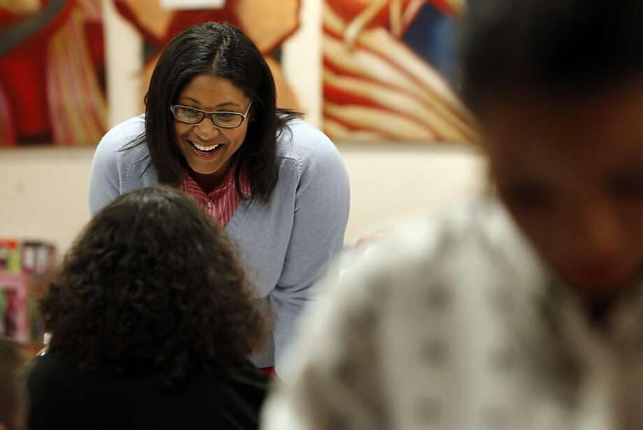 In this file photo, London Breed helps to coordinate holiday gift wrapping at the African American Art & Culture Complex in San Francisco last December. Photo: Carlos Avila Gonzalez, The Chronicle