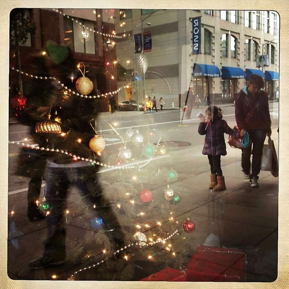 Christmas shoppers move past window displays on San Francisco's Fourth Street on Dec. 20. Photo: Mike Kepka, The Chronicle