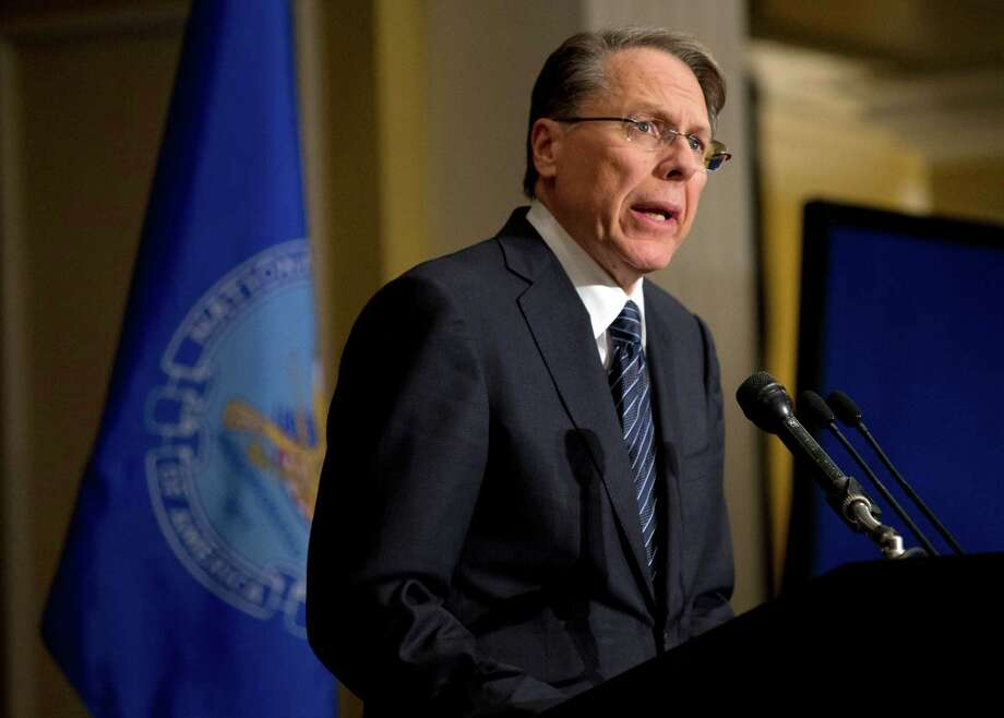"FILE - In this Friday, Dec. 21, 2012 file photo, The National Rifle Association executive vice president Wayne LaPierre, speaks during a news conference in response to the Connecticut school shooting in Washington.  The nation's largest gun-rights lobby is calling for armed police officers to be posted in every American school to stop the next killer ""waiting in the wings."" (AP Photo/Evan Vucci) Photo: Evan Vucci, Associated Press / AP"