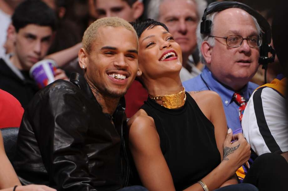 Recording artists Chris Brown and Rihanna attend a game between the New York Knicks and the Los Angeles Lakers at Staples Center on December 25, 2012 in Los Angeles, California. (Photo by Andrew D. Bernstein/NBAE via Getty Images) (NBAE/Getty Images)