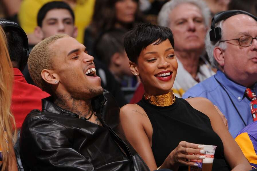 Recording artists Chris Brown and Rihanna attend a game between the New York Knicks and the Los Ange