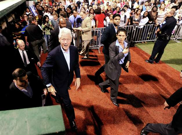 Former President Bill Clinton smiles for the camera after working the crowd with handshakes and kind words after Lampsons Get-Out-The-Vote rally to encourage people to vote early at Vincent-Beck Stadium on Thursday, October 25, 2012.   Photo taken: Randy Edwards/The Enterprise Photo: Randy Edwards