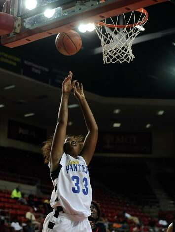 Lady Panther Jerica Bolin, #33, puts the ball up for 2 points during the Port Arthur-Memorial Lady Titans high school basketball game against the Ozen Lady Panthers on Saturday December 1, 2012, in the championship basketball game of the annual BISD YMBL South Texas Shootout at the Lamar University Montagne Center. Port Arthur-Memorial won over Ozen 53-52.  Photo taken: Randy Edwards/The Enterprise