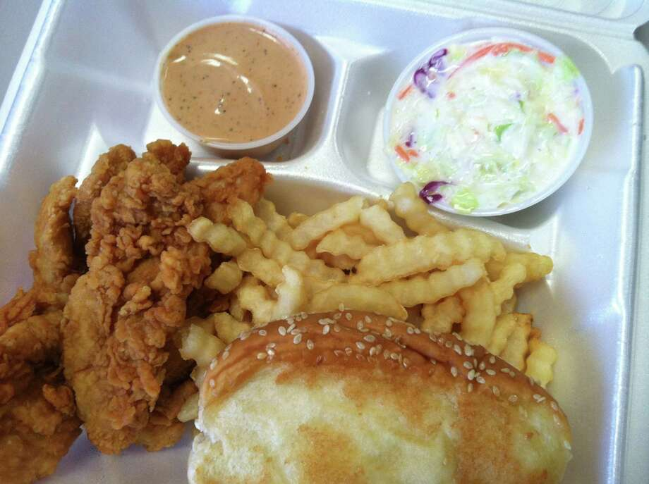 The Box, a combo at Raising Cain's, consists of four chicken fingers, fries, coleslaw, Texas toast and a dipping sauce. Photo: Edmund Tijerina, San Antonio Express-News