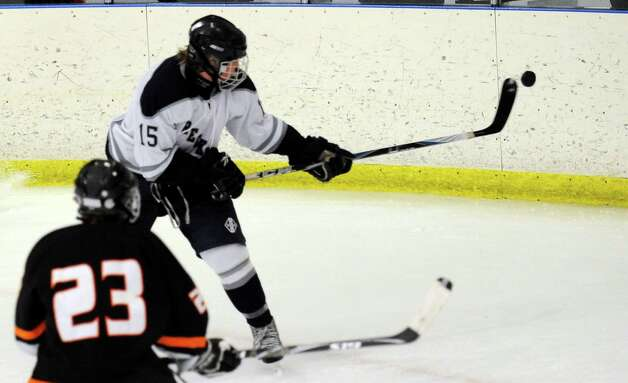 Staples' Ryan Gawricki controls the puck Wednesday Jan. 4, 2012 during their hockey game against Stamford at the Milford Ice Pavilion. Photo: Autumn Driscoll / Connecticut Post