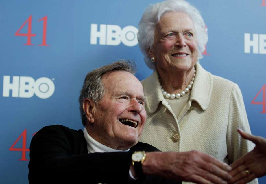 FILE - In a Tuesday, June 12, 2012 file photo, former President George H.W. Bush, and his wife, former first lady Barbara Bush, arrive for the premiere of HBO's new documentary on his life near the family compound in Kennebunkport, Maine. Bush spokesman Jim McGrath said Wednesday, Dec. 26. 2012 that doctors at the Houston hospital where Bush has been treated for a month remain ?cautiously optimistic? that he will recover. Still, no discharge date has been set, and McGrath says that doctors are being cautious because at Bush?s age ?sometimes issues crop up that are beyond anybody?s ability to discern or foretell.?(AP Photo/Charles Krupa, File) Photo: Charles Krupa, STF / AP