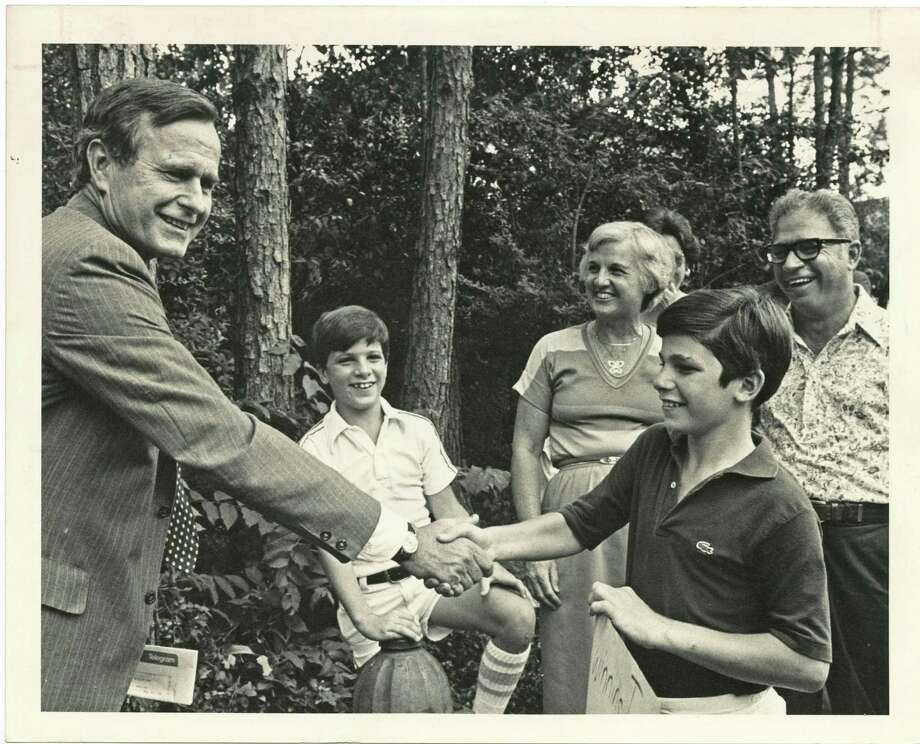 PHOTO FILED: GEORGE HW BUSH-GROUP.  07/19/1980 - George Bush, left, returned in triumph to greet his neighbors near his southwest Houston home Saturday after being tapped by Ronald Reagan for the GOP vice presidential nomination. He took time off from having breakfast at his home with Reagan and a joint appearance at a Galleria rally to shake hands with neighbors Walter and Lois Taber and their children, Keith and Tom.  David Breslauer / Houston Chronicle Photo: David Breslauer, Houston Chronicle / Houston Chronicle