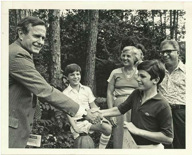 PHOTO FILED: GEORGE HW BUSH-GROUP.  07/19/1980 - George Bush, left, returned in triumph to greet his