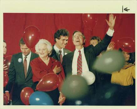 11/07/1988 - Barbara Bush and her husband, Republican presidential candidate George Bush, respond to the cheering crowd at a pre-election day rally at the Galleria late Monday afternoon, Nov. 7, 1988. Mary Urech Roberts / Houston Post Photo: Mary Urech Roberts, Houston Chronicle / Houston Post files