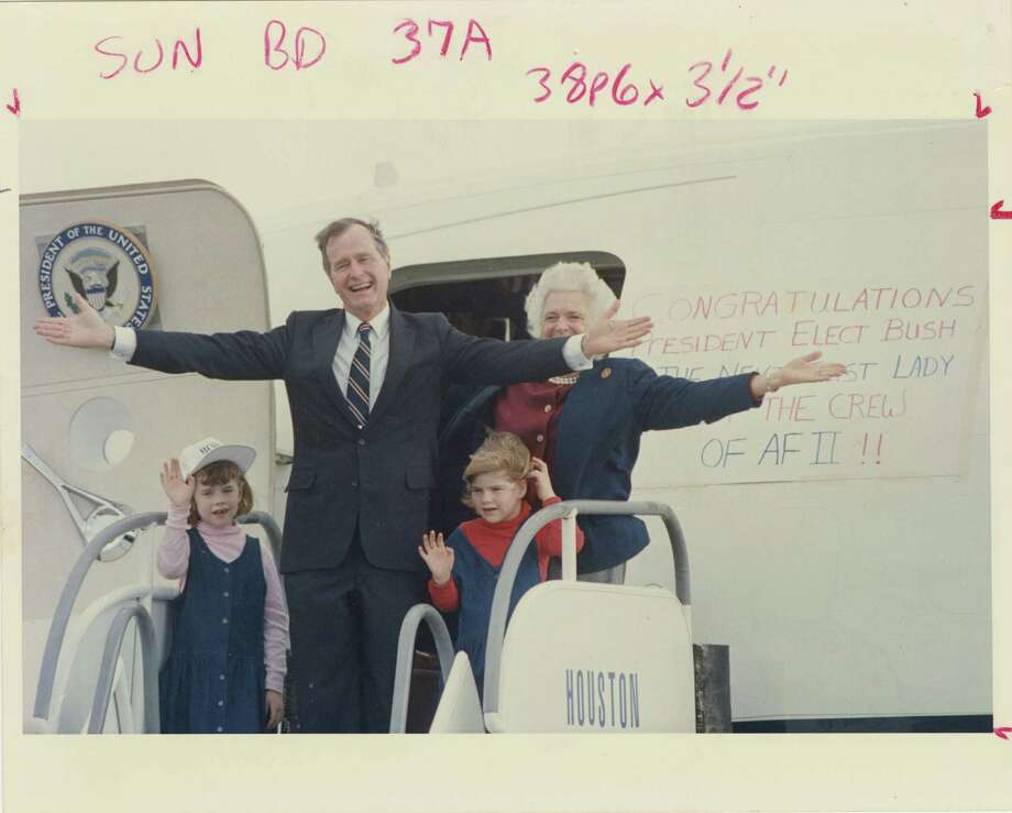 11/09/1988 - President-elect George Bush, his wife, Barbara, and his grandchildren, Jenna (left) and Barbara wave to well-wishers before they board a jet at Ellington Field the day after his election victory.  At right can be seen a congratulatory sign prepared by the crew.  King Chou Wong / Houston Post Photo: King Chou Wong, Houston Chronicle / Houston Post files