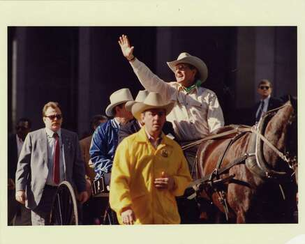 02/20/1988 - Vice President George Bush, Republican candidate for president, serves as grand marshal of the Houston Livestock Show and Rodeo parade. Bush waves to parade goers in downtown Houston, Saturday, Feb, 20, 1988. Jerry Click / Houston Post Photo: Jerry Click, Houston Chronicle / Houston Post files