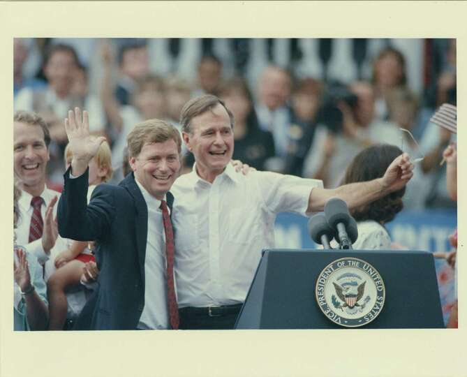 08/16/1986 - Vice President George Bush, right, and Indiana Sen. Dan Quayle wave to the crowd after