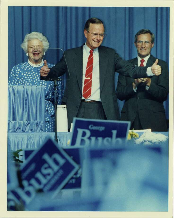 06/09/1988 - Vice President George Bush waves to delegates attending the Texas Republican Party convention at the George R. Brown Convention Center. Behind him are his wife, Barbara Bush, and Texas GOP Chairman George Strake.  Craig Hartley / Houston Post Photo: Craig Hartley, Houston Chronicle / Houston Post files