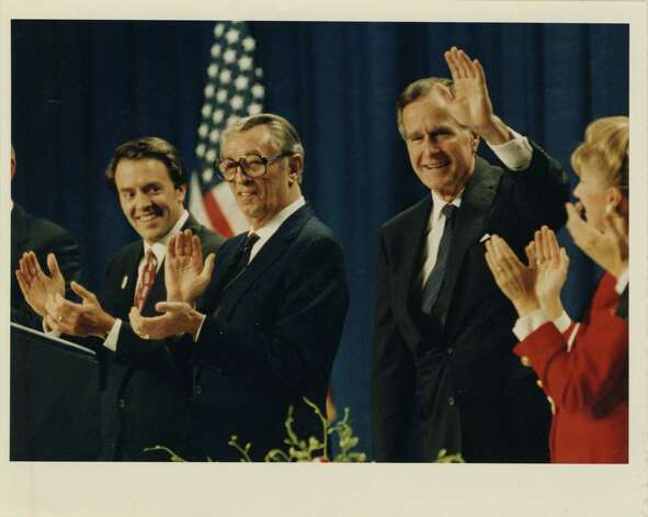 10/08/1992 - President George Bush waves to crowd at a Republican Victory '92 fund-raiser at the J.W. Marriott Hotel. With him on the podium were Rob Mosbacher, left, and actor Robert Mitchum, who acted as master of ceremonies.  Photo: John Makely, Houston Chronicle / Houston Post files
