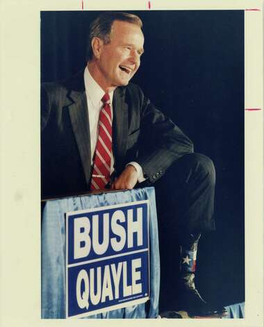 08/27/1988 - Republican presidential candidate George Bush shows his Texas stripes, displaying a pair of cowboy boots emblazoned with the state flag during a Republican Victory 88 meeting at Houston's Stouffer's Hotel Saturday, Aug. 27, 1988. Photo: Ira Strickstein, Houston Chronicle / Houston Post files