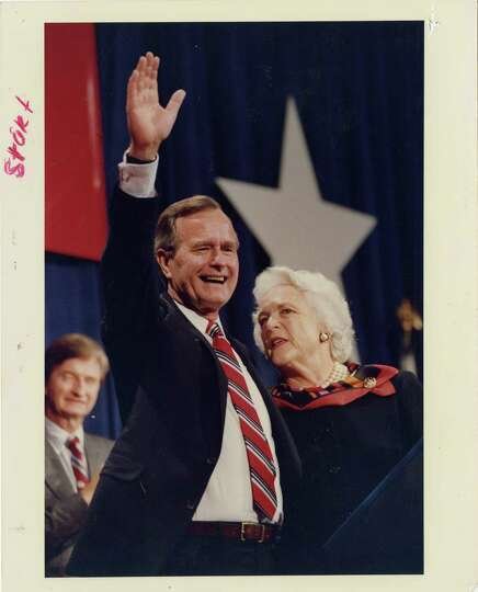 11/08/1988 - President-elect George Bush waves to the crowd at convention center following his victo