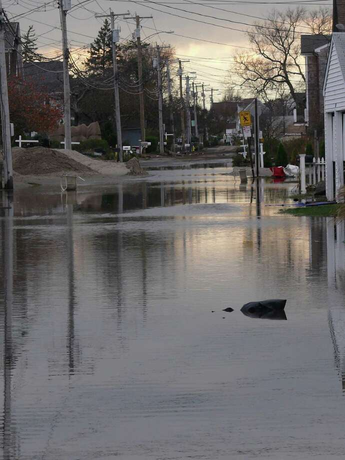 Parts of Fairfield Beach Road remained impassable, blocked by water or sand, and homes uninhabitable, following Superstorm Sandy. Photo: Genevieve Reilly / Fairfield Citizen