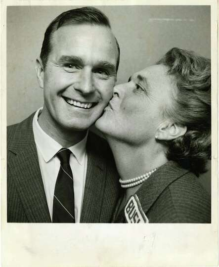 11/08/1966 - Newly-elected Congressman George Bush flashes a winner's smile as his wife, Barbara, gi