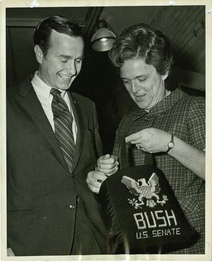 05/02/1970 - U.S. Senate candidate George Bush and his wife, Barbara, rummage in her bag at their vo