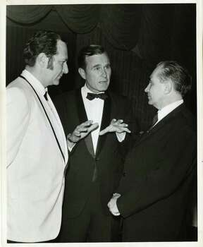 05/20/1970 - (L-R) Professor Nicolai Blokhin of Moscow, U.S. Rep. George Bush and Dr. Emil Freireich of Houston at dinner given by Houston chapter of the Leukemia Society of America. Bela Ugrin / Houston Post   HPOST CAPTION (05/21/1970): Congressman George Bush (center) captured the attention of Professor Nicolai Blokhin of Moscow and Dr. Emil Freireich (left) of Houston at a dinner Wednesday night at the Shamrock Hilton Hotel. It was given by the Houston chapter of the Leukemia Society of America and attracted many of the delegates to the forthcoming International Cancer Congress which starts Friday. Blokhin is the congress president. Photo: Bela Ugrin, Houston Chronicle / Houston Post files