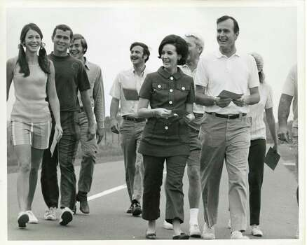 "05/30/1970 - George W. Bush (2nd from left) and his father, U.S. Rep. George HW Bush (far right, white shirt) participate in the 20-mile charity,  ""Walk for Mankind.""  Funds were raised for three volunteer service groups. Sponsors were soliicited to pay for each mile walked by the participant. Jim Cox / Houston Post Photo: Jim Cox, Houston Chronicle / Houston Post files"