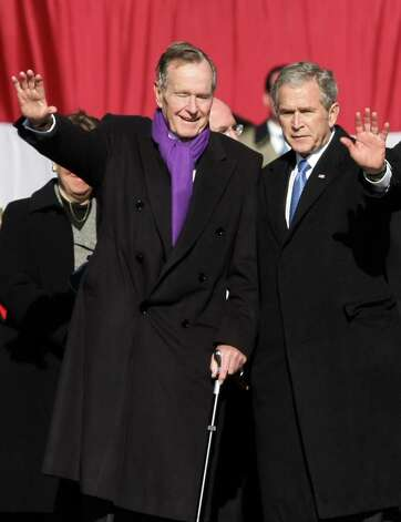 FILE - NOVEMBER 29: Former U.S. President George H.W. Bush has been hospitalized with bronchitis in Houston, Texas for six days, his spokesman said on November 29, 2012. NORFOLK, VA - JANUARY 10:  Former president George H.W. Bush and current President George W. Bush wave at the commissioning ceremony for the Navy's newest aircraft carrier the George H.W. Bush (CVN 77), named after the President's father the former President, at Naval Station Norfolk on January 10, 2009 in Norfolk, Virginia. The George H.W. Bush (CVN 77) is a 97,000-ton aircraft carrier built for $6.2 billion and is the first aircraft carrier since the USS Ronald Regan was commission in 2003. Photo: Jason Hirschfeld, Getty Images / 2009 Getty Images