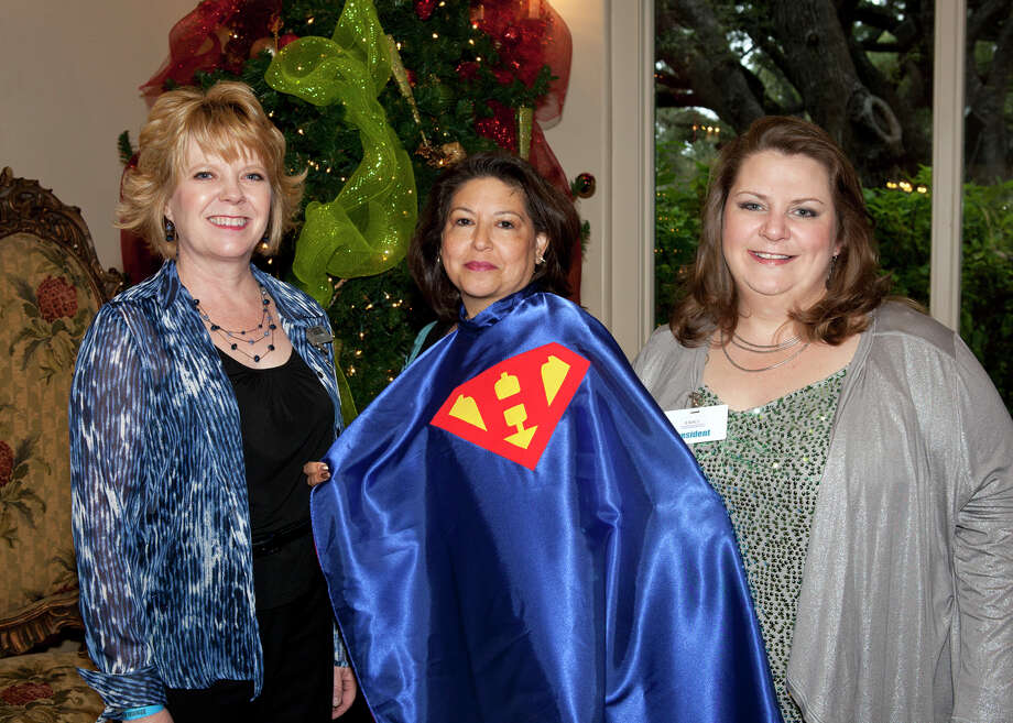 Alamo Area Home Care Council  communications  officer Tammy Coleman (from left), 2012 Home Care Hero Angela Pena and  council President Candyce Slusher get together during a Christmas event at Oak Hills Country  Club.