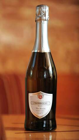 A bottle of Casa V Prosecco which was taste tested at the Wine Bar on Lark St. on Wednesday Dec. 12, 2012 in Albany, N.Y.  (Lori Van Buren / Times Union) Photo: Lori Van Buren