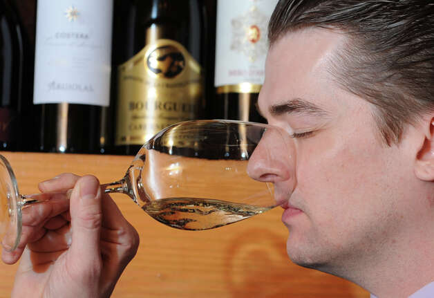 Bartender Jonathan Stewart is the tester for Prosecco at the Wine Bar on Lark St. on Wednesday Dec. 12, 2012  in Albany, N.Y.  (Lori Van Buren / Times Union) Photo: Lori Van Buren