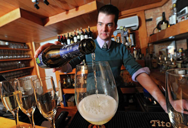 Bartender Jonathan Stewart, the tester for a Prosecco taste test at the Wine Bar on Lark St., pours some Prosecco into a wine glass on Wednesday Dec. 12, 2012 in Albany, N.Y.  (Lori Van Buren / Times Union) Photo: Lori Van Buren