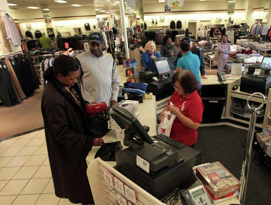 J.C. Penney sales associate Marietta Bayaua helps Brenda Johnson, left, and husband Harry Johnson check out Wednesday at the J.C. Penney store in Meyerland Plaza. Photo: James Nielsen, Staff / © Houston Chronicle 2012