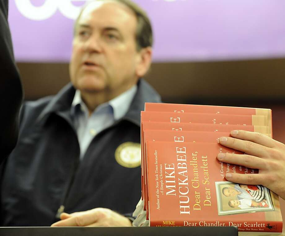 "Former Arkansas Governor and 2008 Republican Presidential Candidate Mike Huckabee signed copies of his new book ""Dear Chandler, Dear Scarlett"" at Family Christian Stores on on Thursday, Nov. 29, 2012. (AP Photo/The Kalamazoo Gazette, Matt Gade) Photo: Matt Gade, Associated Press"