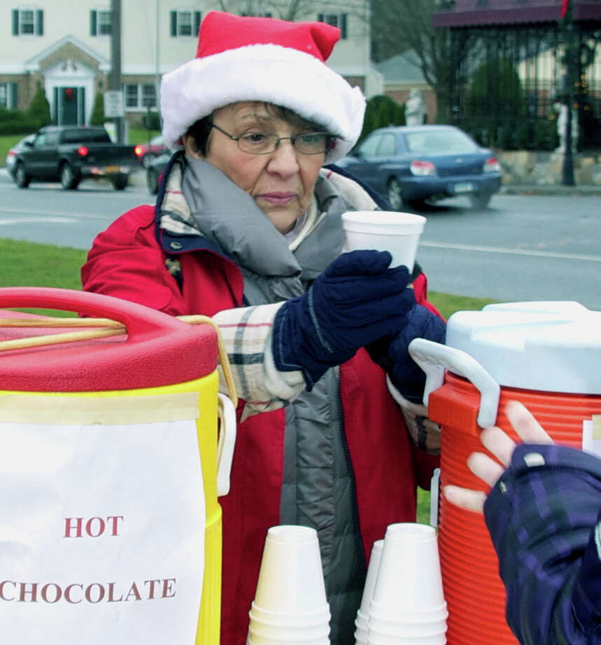 Linda Kamp of Housatonic Valley Insurance serves up hot chocolate and cider during Prudential Connecticut Realty and Housatonic Valley Insurance's annual Holiday on the Green, Dec. 16, 2012 in New Milford. Photo: Trish Haldin