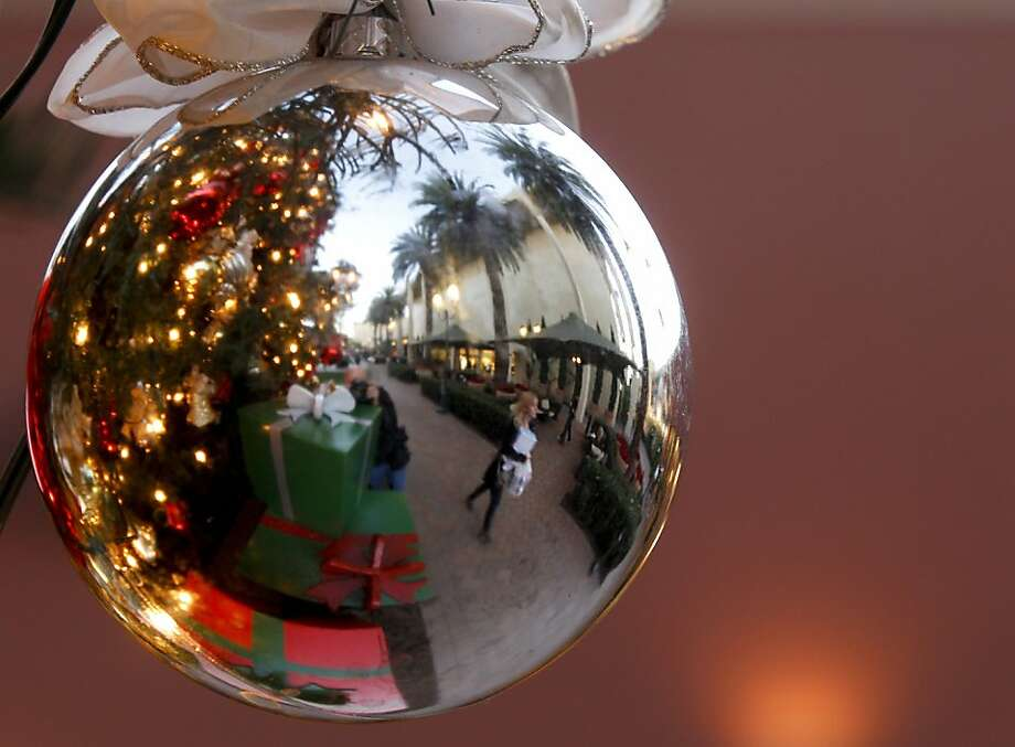 Economic and weather worries slowed holiday retail sales this year. Photo: Chris Carlson, Associated Press