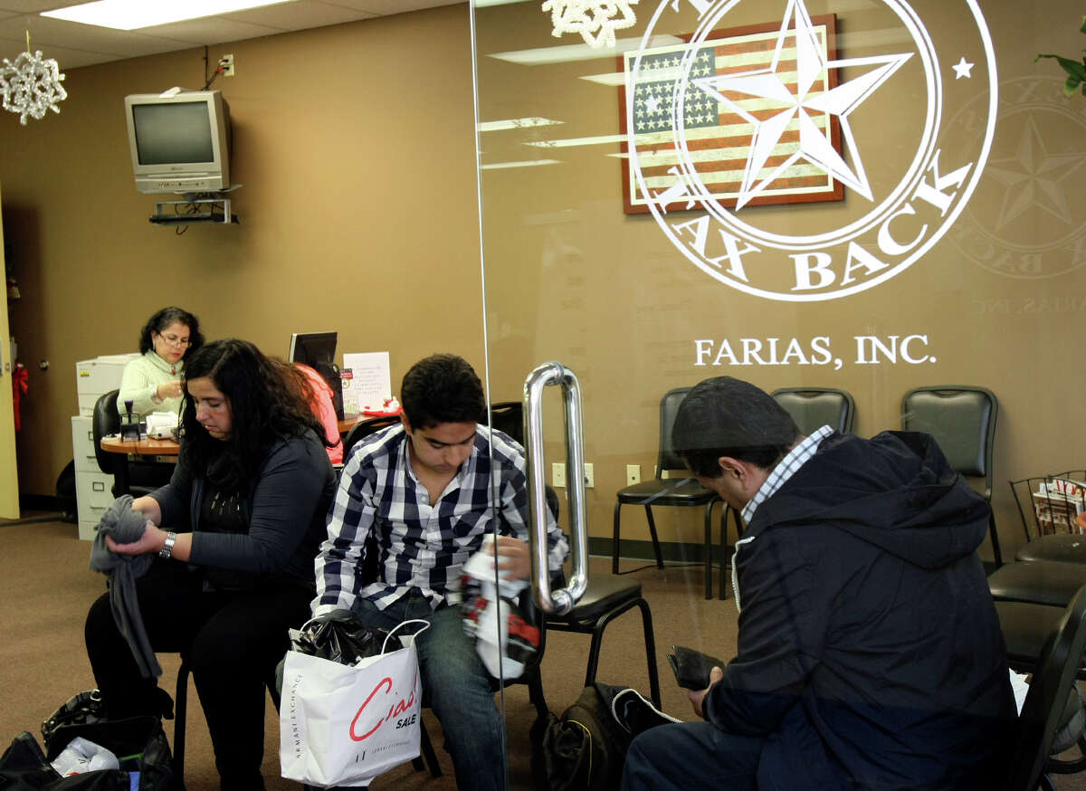 Julia Paramo, son Joaquin Capistran and husband Joaquin Capistran sort through purchases and receipts at a Texas Tax Back office, which helps international visitors get sales tax refunds.