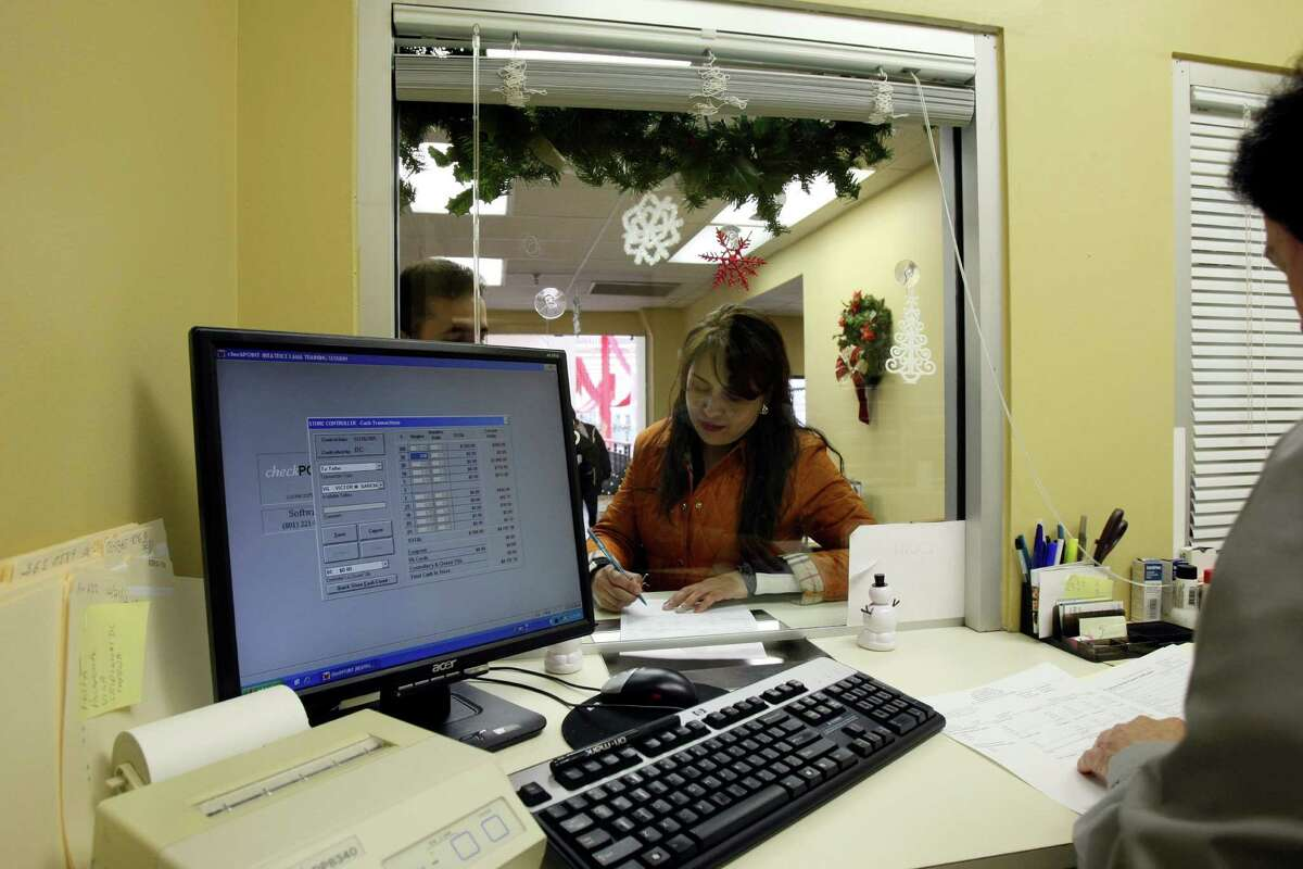 Maria Guadalupe Valdez files out paperwork to collect sales taxes at Texas Tax Back before heading back to Mexico. The day after Christmas kicks off a busy time of year for companies like Texas Tax Back which helps international visitors quickly collect sales tax refunds.