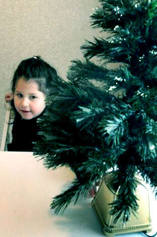 Vanessa Hernandez, 5, checks out the Christmas tree in her new home at Faith Church in New Milford. Her family is one of those from Staten Island, N.Y. displaced by Hurricane Sandy. Dec. 23, 2012 Photo: Michael Duffy