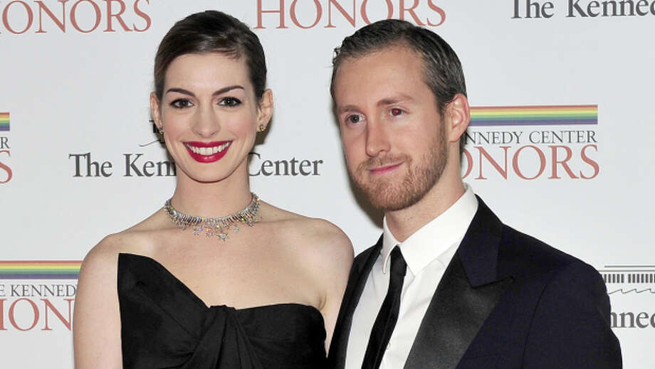 "Married: Anne Hathaway and Adam Shulman were married on Sept. 29, and Anne had short hair after shaving it for her role in ""Les Miserables."" Photo: Ron Sachs, Getty"