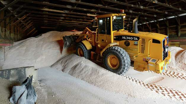NYS DOT operator Don Cleveland moves tons of salt are delivered DOT garage in Latham, N.Y. Dec 26, 2012 in preparation for the storm that is forecast for the Capital District tonight and tomorrow. (Skip Dickstein/Times Union) Photo: SKIP DICKSTEIN / 00020573A