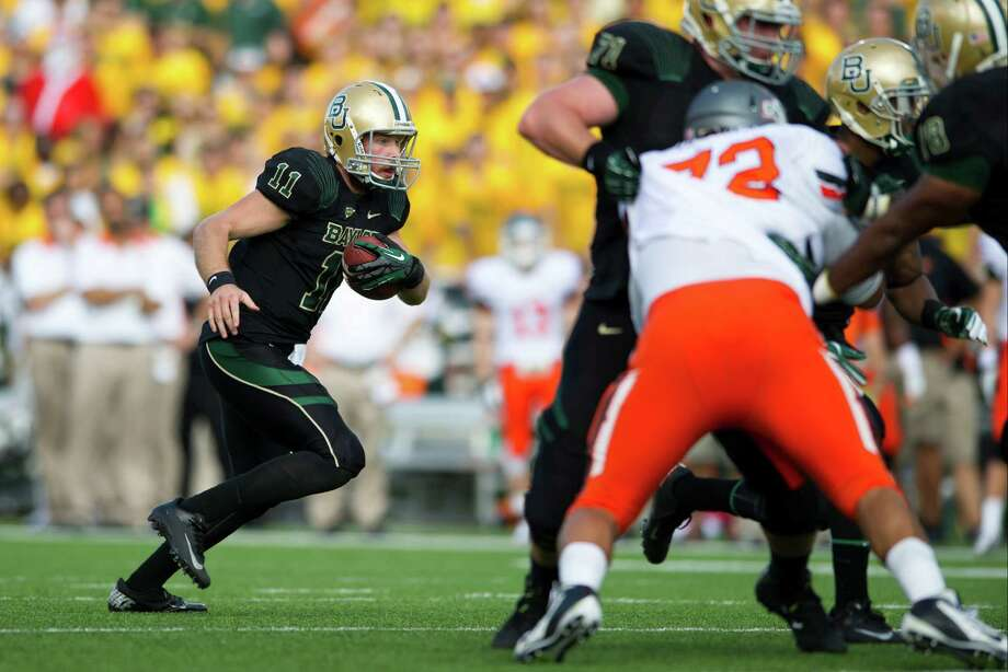 Nick Florence #11 of the Baylor University Bears carries the ball against the Oklahoma State University Cowboys on December 1, 2012 at Floyd Casey Stadium in Waco, Texas. Photo: Cooper Neill, Getty Images / 2012 Getty Images