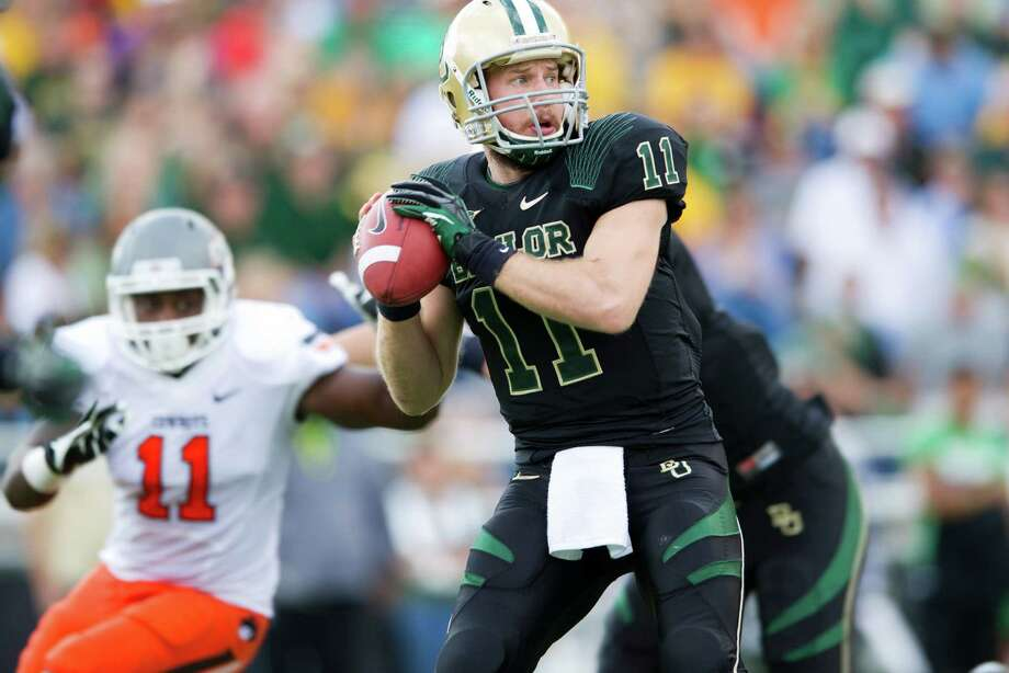 Nick Florence #11 of the Baylor University Bears throws a pass against the Oklahoma State University Cowboys on December 1, 2012 at Floyd Casey Stadium in Waco, Texas. Photo: Cooper Neill, Getty Images / 2012 Getty Images